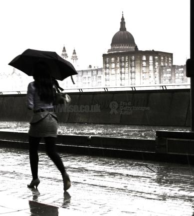 Business woman in rain - London
