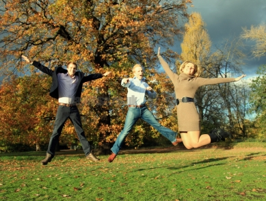 teens jumping in Autumn